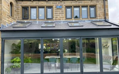 Brown Windows and White Trims sprayed Anthracite Grey to match Bifolding Doors